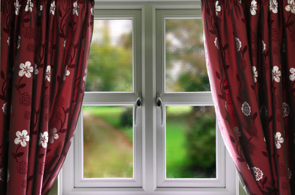 uPVC Windows with red curtains