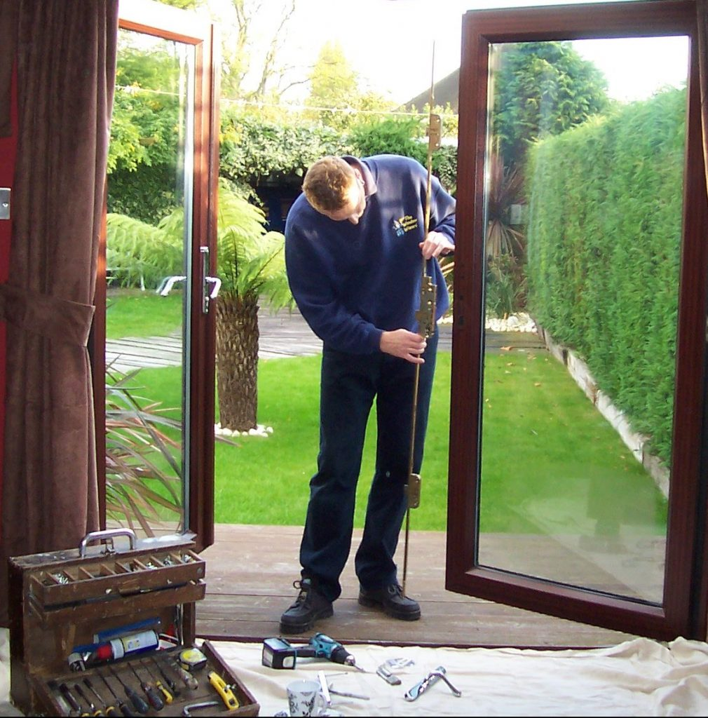 qualified person carrying out adjustments to a uPVC back door